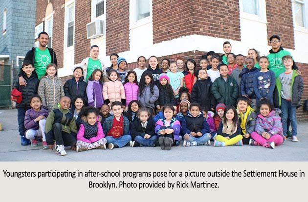 Youngsters participating in after-school programs pose for a picture outside the Settlement House in Brooklyn. Photo provided by Rick Martinez.
