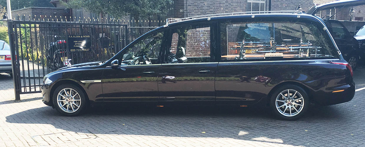 A custom Jaguar hearse is among funeral vehicles in the fleet at F.A. Albin & Sons in London