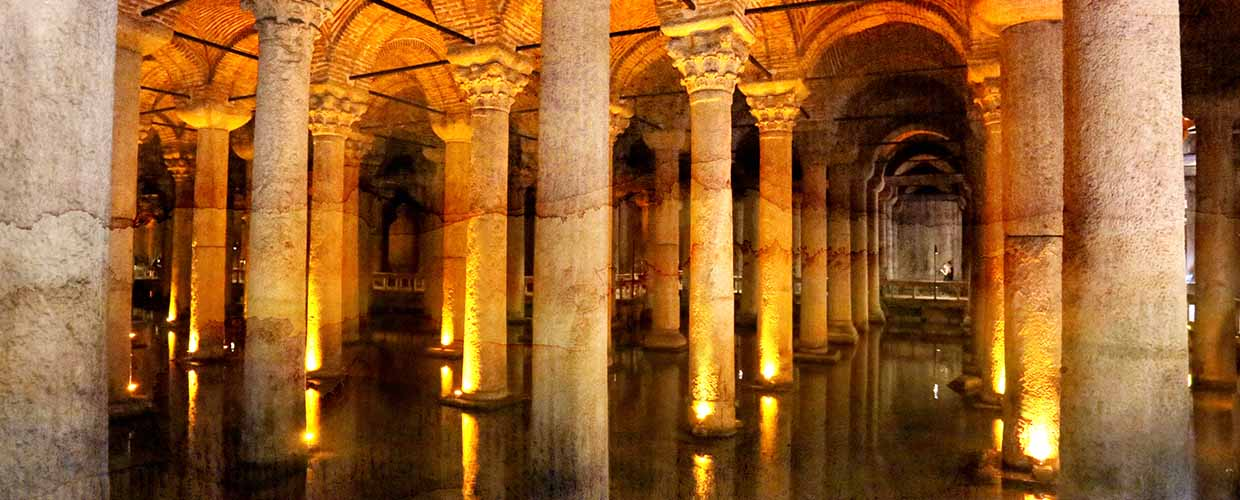 "Photo of historic, stone-column filled candle-lit building titled ""Ancient Catacombs"" by Tanor"