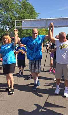 Funeral Director David Murphy celebrates completing a 5K marathon