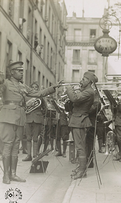 James Reese Europe leads the 369th Regiment Military Band Outside a Paris Hospital, 1918. Image from the Library of Congress