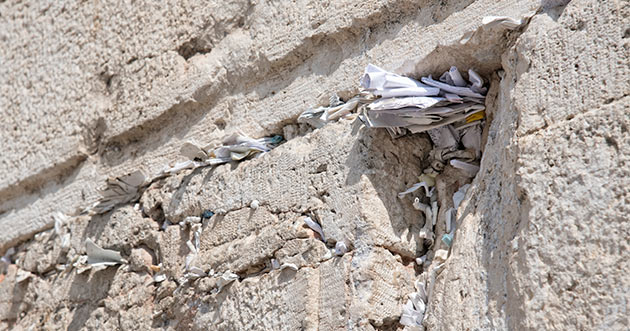 Notes are visible in the Western Wall of Jerusalem in Israel