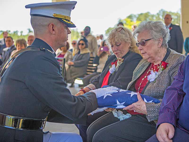 Folded flag is given to family members of the deceased veteran during Military Honors Funerals