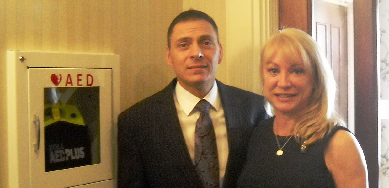 Funeral Directors David Parente and Kristin McVeigh with AED at McVeigh Funeral Home in Albany, NY