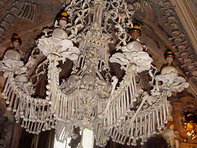 A Chandelier made of Bones and Skulls in Sedlec Ossuary. From Wikipedia, Photographer: en:User:Chmouel