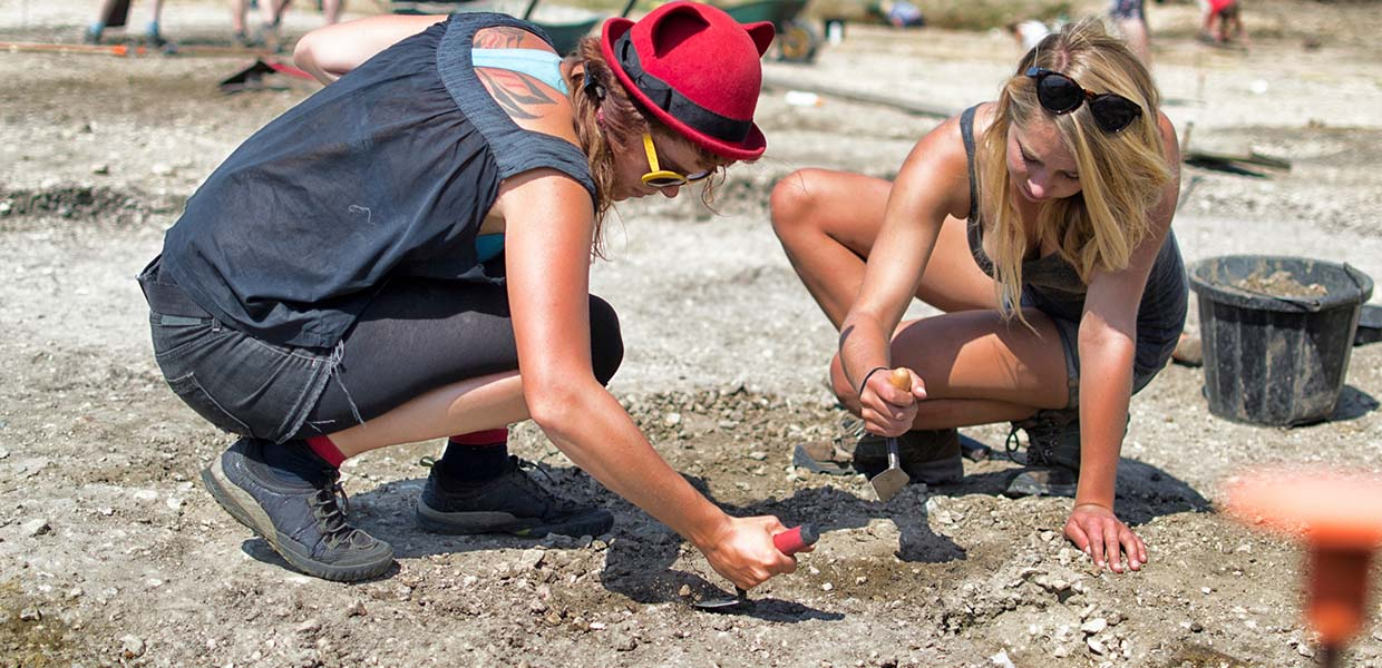 Photo of Archaeologists Probably Digging Somebody Up
